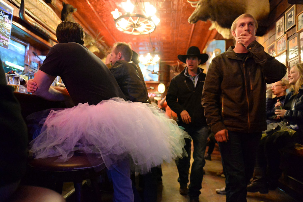 "Justin Sheely | The Sheridan Press<br /> Patrons walk by as tutu-wearing activists enjoy drinks during the ""Live and Let Tutu"" response Saturday night at the Mint Bar in Sheridan. Sheridan residents took part in a state-wide response to comments made by U.S. Sen. Mike Enzi, R-Wyoming, to middle school students in Greybull on April 20, when he was asked about federal protections for LGBT people. The senator reportedly said that he knows a guy who wears a tutu to bars and and always surprised that he gets in fights, ""he kind of asks for it a little bit."" Enzi said."