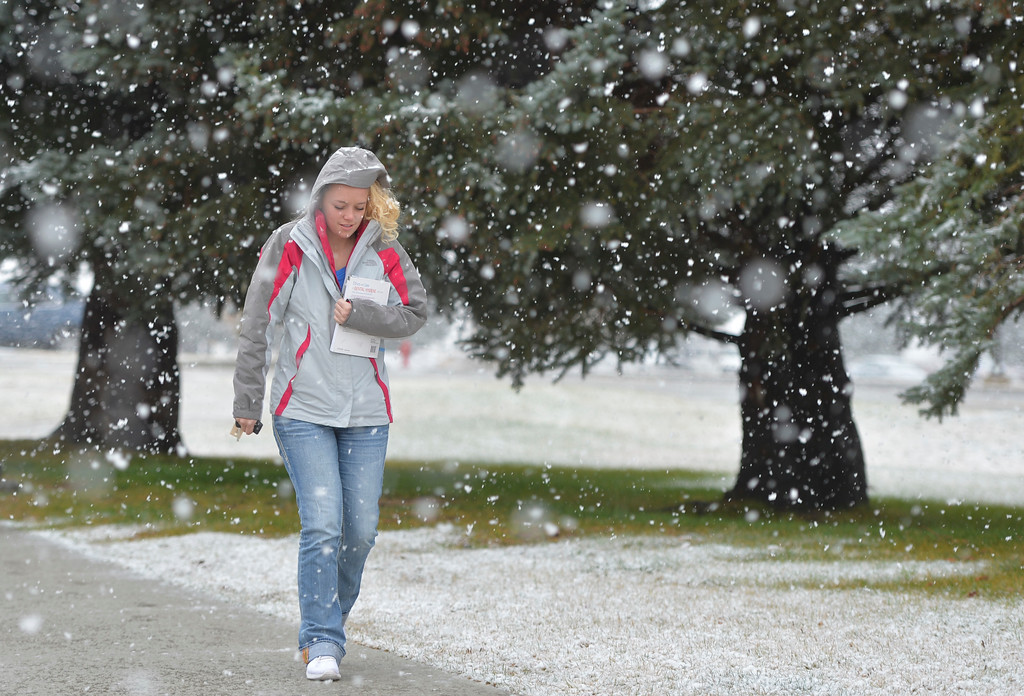 Justin Sheely | The Sheridan Press<br /> College student Katlyn Tippetts walks across campus as snow falls Wednesday morning at Sheridan College. The National Weather Service in Billings, Montana, issued a hazardous weather outlook for the Sheridan area. Expect snow and poor driving conditions into the weekend.