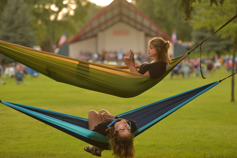 Justin Sheely | The Sheridan Press<br /> Alix Hegy, top, and Delainy Szmyd hang out in their hammocks as live music is played during Concerts in the Park Tuesday evening at Kendrick Park.