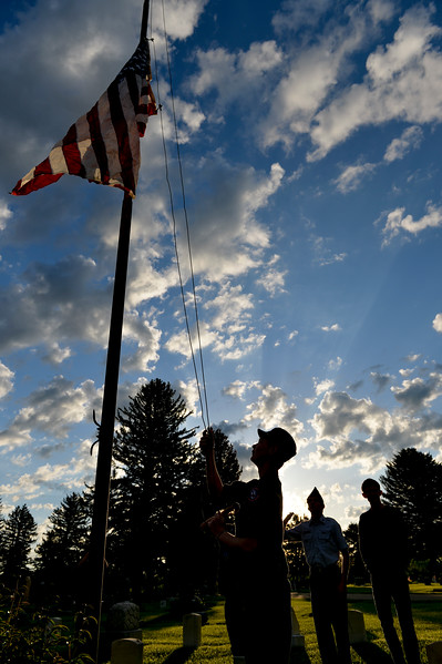 Justin Sheely | The Sheridan Press<br /> Members of the Civil Air Patrol raise the flag during the morning decorating on Memorial Day at the Sheridan Municipal Cemetery. Members of the American Legion Post #7, Veterans of Foreign Wars, Disabled Veterans and community members decorated the headstones of veterans with flags.