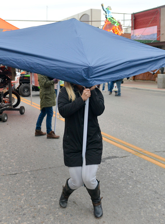 Justin Sheely | The Sheridan Press<br /> People set up a tent during Third Thursday on Main Street.