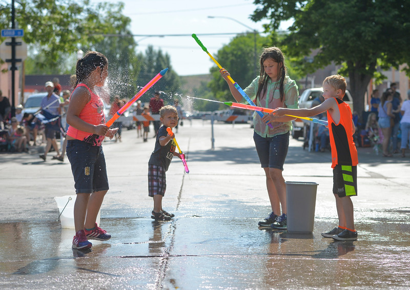 Justin Sheely | The Sheridan Press<br /> Children spray each other with water guns as they wait for the Sheridan WYO Rodeo Parade Friday morning on Main Street. From left, Adyson Rosalez, 6, Taisyn Merker, 3, Kiaya Allen, 11, and Briston Heide, 7.