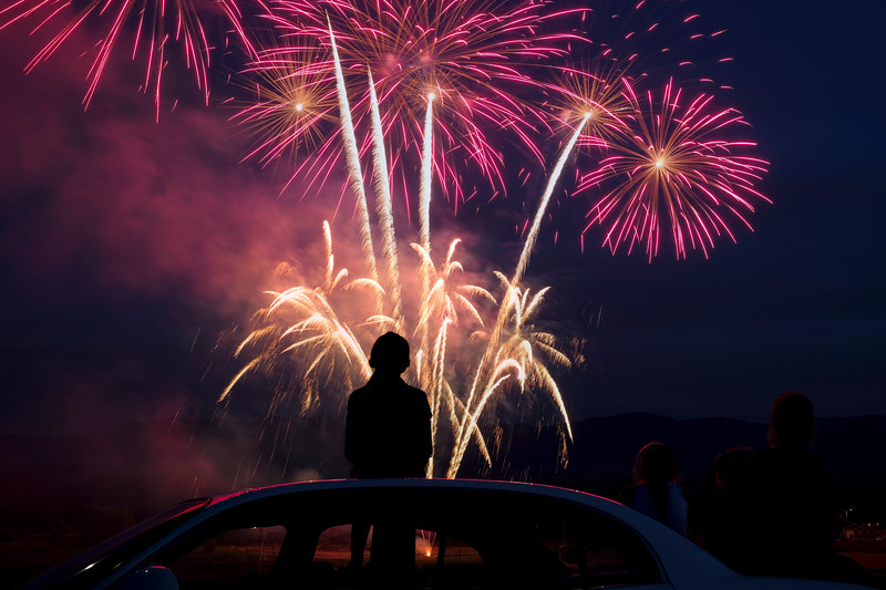 Justin Sheely | The Sheridan Press <br /> Onlookers watch the fireworks display over the town of Ranchester Tuesday night in celebration of Independence Day.