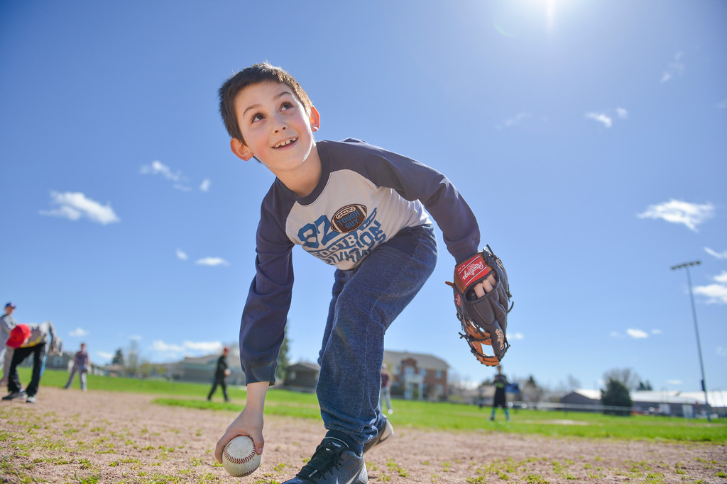 Justin Sheely | The Sheridan Press<br /> Mickey Gillis retrieves the ball during Sheridan Recreation District's Spring Baseball Clinic Saturday at Oatts Field in Sheridan.