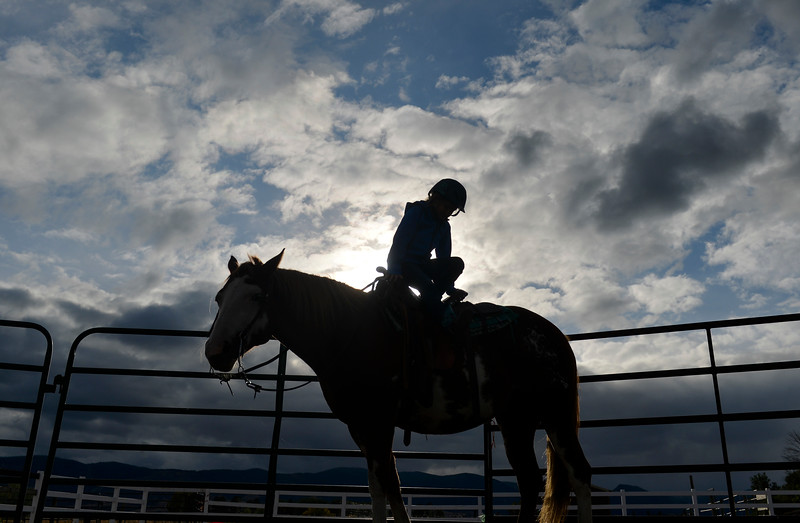 Justin Sheely | The Sheridan Press<br /> Eight-year-old Chloie Wardell practices riding backwards for a confidence building exercise earlier this month at Hanna Creek Acres near Big Horn. The Copenhavers have trained horses and riders at Hanna Creek Acres for 15 years. The core of Ralph Copenhaver's training technique is to teach horse and rider to trust each other through gentle and respectful interactions.
