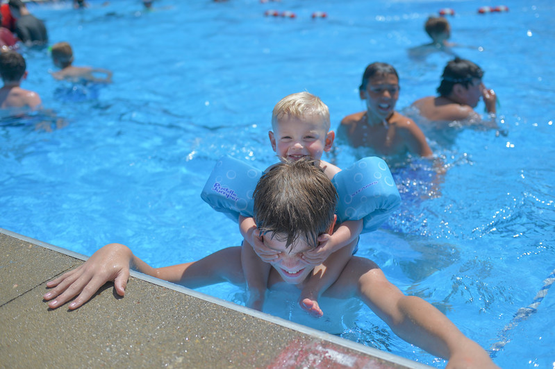 Justin Sheely | The Sheridan Press<br /> Thirteen-year-old Peyten Wilson plays with his cousin Kyler Drell, 2, Wednesday at Kendrick Pool. The pool is open 1 - 7 p.m. daily, Sunday admission is only $1. The pool closes for the season August 26.