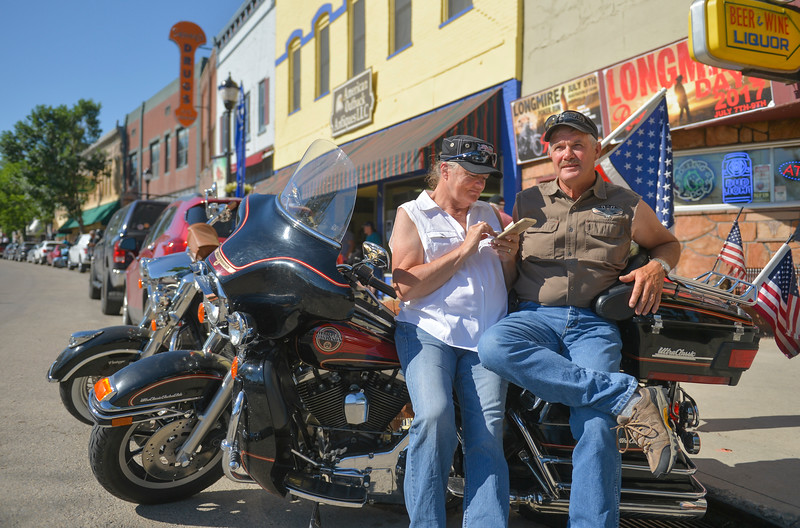 Justin Sheely | The Sheridan Press <br /> Longmire fans Dixie Erickson and Arnie Erickson of Gillette, Wyoming, wait for the parade to begin during the sixth annual Longmire Days Saturday on Main Street in Buffalo, Wyoming. The show is based on local author Craig Johnson's novels set in the fictional town of Durant, inspired by the town of Buffalo. Longmire's sixth and final season will be on Netflix sometime this year.