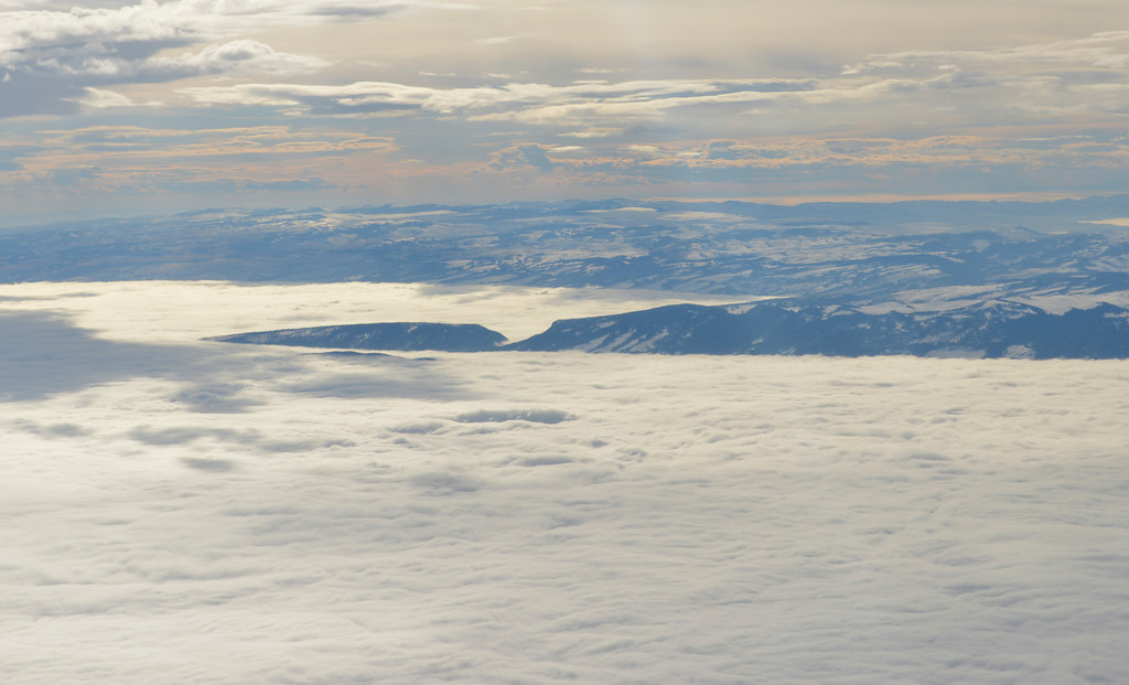 Justin Sheely | The Sheridan Press<br /> The Bighorn Mountains rise above a sea of clouds as seen from a free scenic flight on a Denver Air Connection Dornier 328 jet Friday afternoon. Sheridan County paid for 40 scenic flights to help DAC hit the 10,000-enplanement mark for 2017 for the Sheridan County Airport to qualify for a $1 million capital improvement funding from the Federal Aviation Administration Airport Improvement Program.
