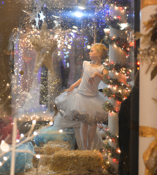 Justin Sheely | The Sheridan Press<br /> Rylan Dudley twirls as an angel in the window at Once Upon a Story during the annual Christmas Stroll Friday in downtown Sheridan.