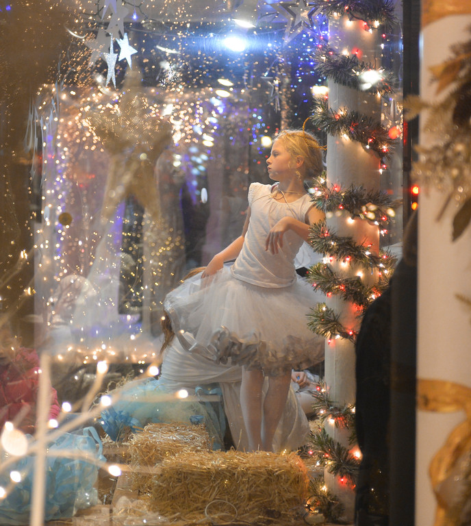 Justin Sheely | The Sheridan Press	<br /> Rylan Dudley twirls as an angel in the window at Once Upon a Story during the annual Christmas Stroll Friday in downtown Sheridan.