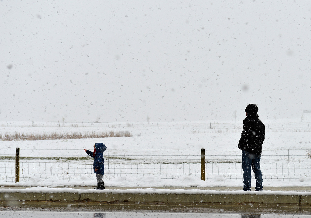Justin Sheely | The Sheridan Press<br /> Three-year-old Kaizen Trujillo and his dad Codie Trujillo walk up W. 5th street as snow falls around them Thursday afternoon.