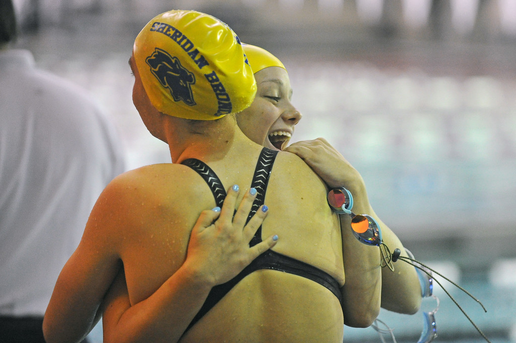 Olivia Thoney, right, embraces teammate Pippin Robison after winning the 200-yard medley relay at the 4A state swim meet on Saturday, Nov. 4 at the Campbell County Aquatic Center. Mike Pruden | The Sheridan Press
