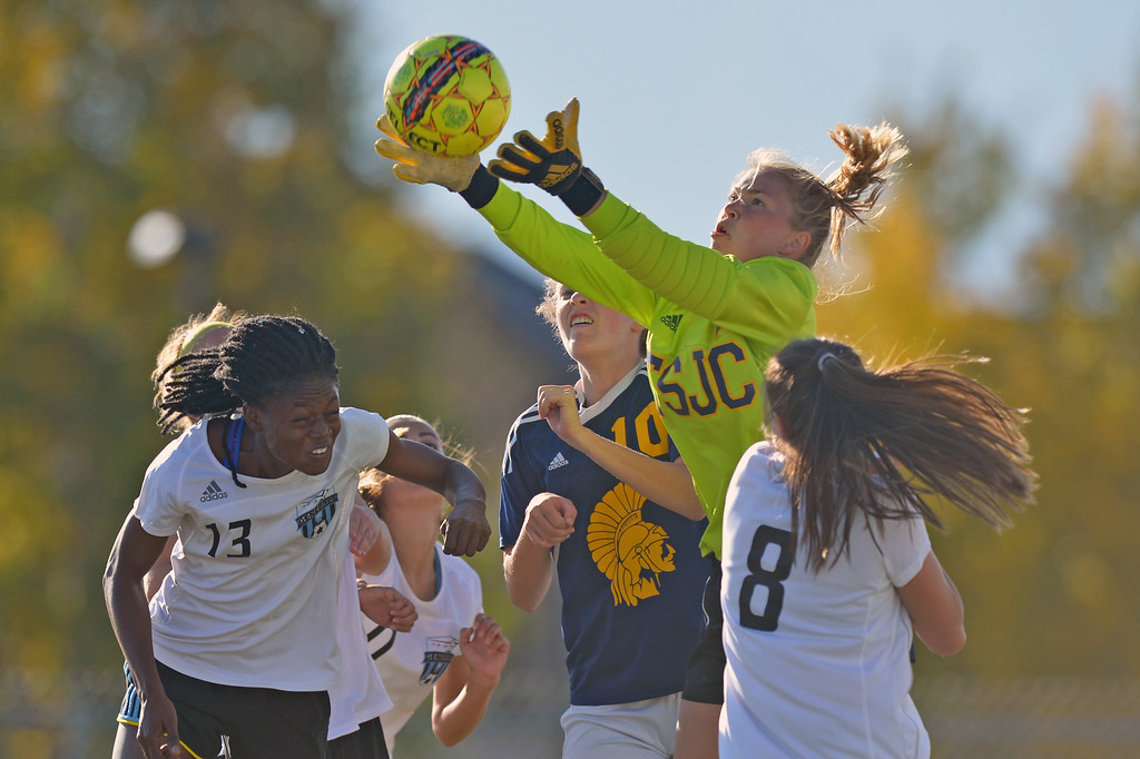 Trinidad State goalkeeper Maizy Burbank leaps to save the ball as Sheridan College's Fortune Kede (13) attempts to score on a corner kick on Friday, Oct. 20 at Maier Field. Mike Pruden | The Sheridan Press