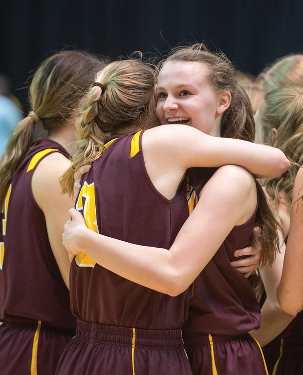 Mike Dunn | The Sheridan Press<br /> Sydney Schmidt, right, celebrates with a teammate after the 2A girls state title game Saturday at the Casper Events Center. The Lady Rams won their first state title since 2009.