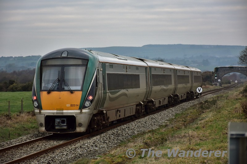 22014 has just crested the climb up Maddam's Hill Bank and is pictured passing XT110 Nash D./White P. at Knockeenduff outside Killarney with the 1325 Mallow - Tralee. Sat 21.01.17