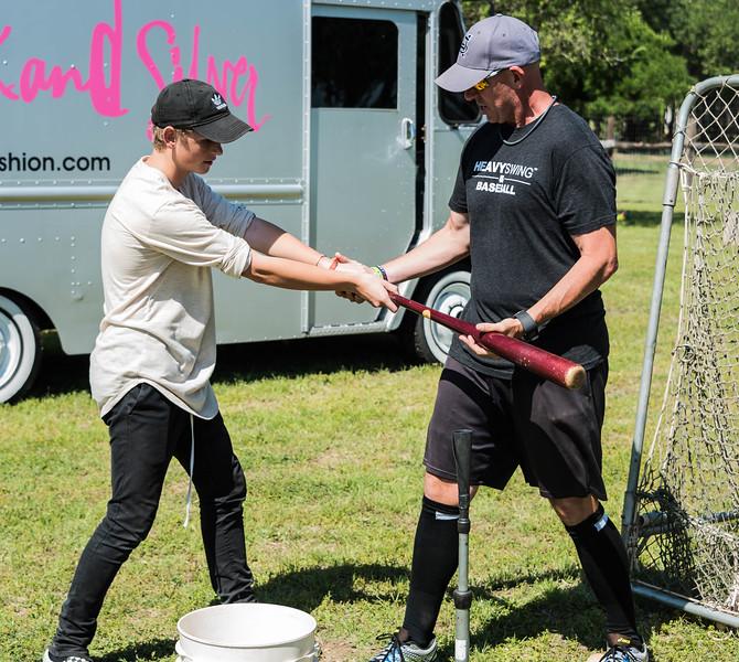 Jason Stein working with Luke Wilkins on his swing