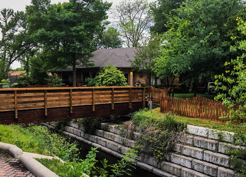 Newly stained bridge and fence at the Cement Crick