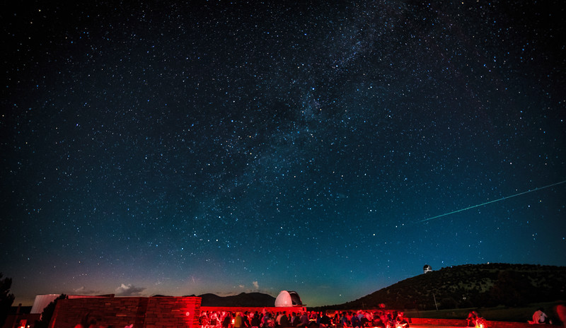Milky Way and huge meteor over McDonald Observatory star party crowd