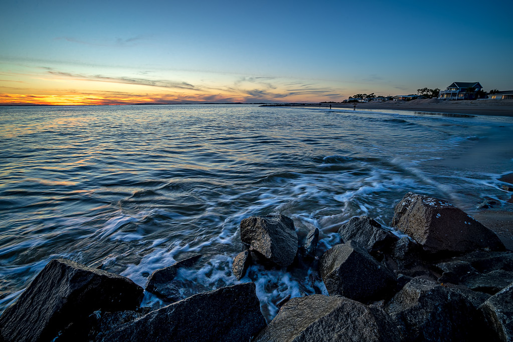 Waves and a jetty at sunset in the Atlantic Ocean at Edisto beach south carolina