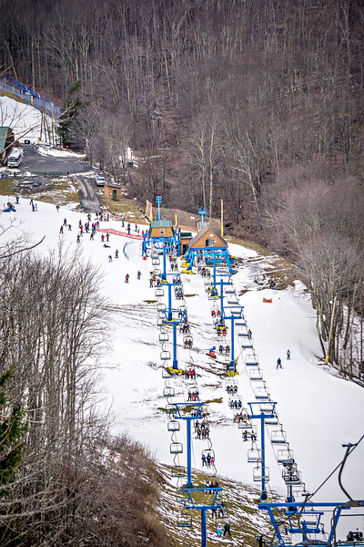 busy skiing season at a winter place ski resort