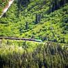 SKAGWAY, ALASKA, USA - JUNE 2017 - Alaskan Canadian White Pass train ride attraction through british columbia canadian rocky mountains