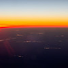 beautiful sunset view from an airplane over land