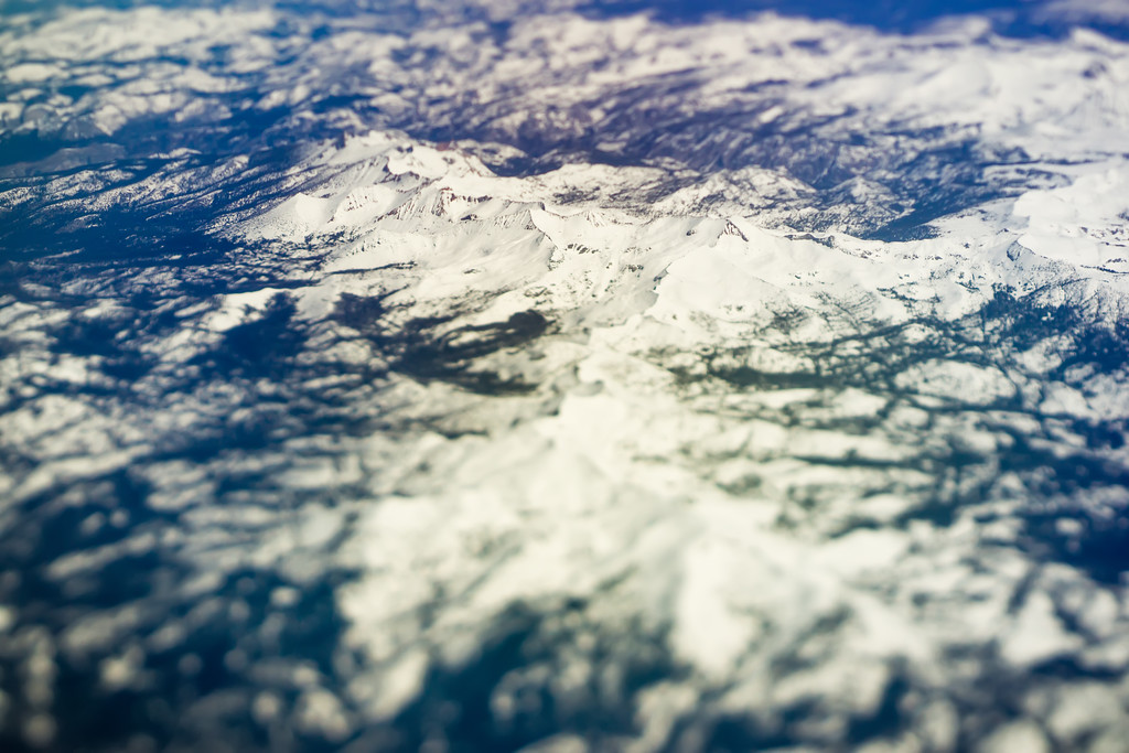 flying over california mountains in spring