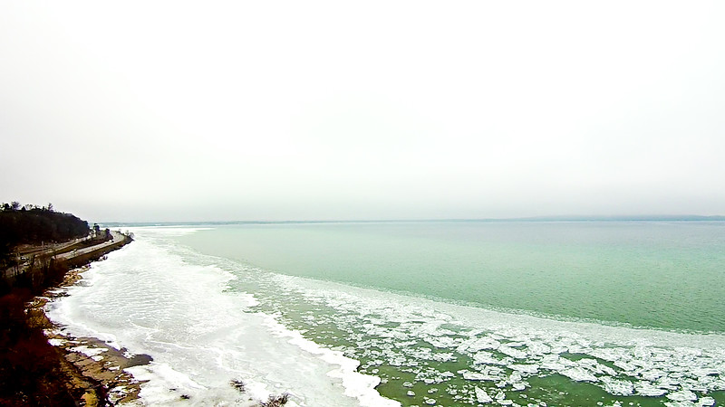 spring time over lake michigan with frozen coastline