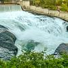 Falls and the Washington Water Power building along the Spokane river