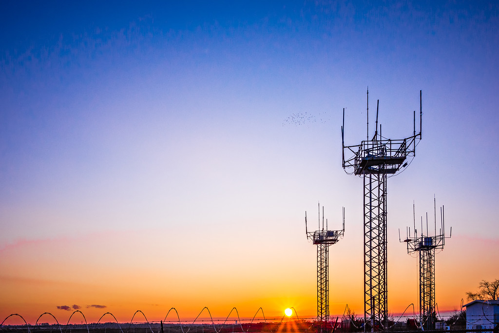 airport communication towers at sunset