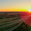 morning sunrise over highway clover leaf road interchange in north carolina