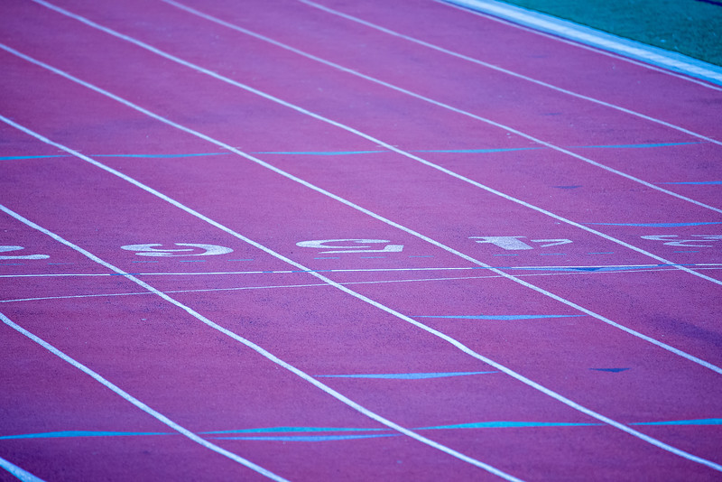 painted line on a athletic running track field