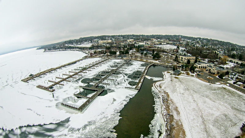 Petoskey Harbor Breakwater in spring with frozen lake