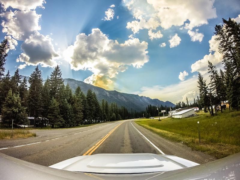 driving through montana vast mountain landscapes,
