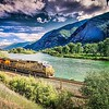montana landscapes with heavy train engine locomotive passing through