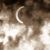 Partial Solar Eclipse Through Clouds
