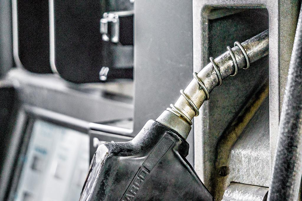 filling up vehicle at gas station pump