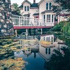 beautiful historic home details and nature pond with reflection