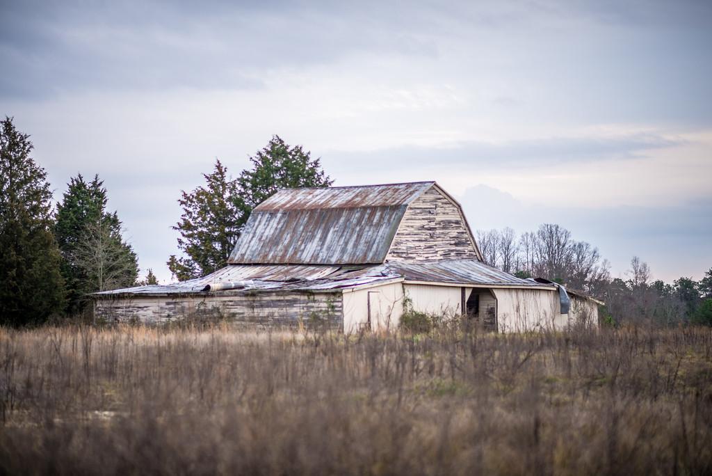 old barn standing on farm landscape