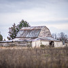 old barn standing on farm landscape
