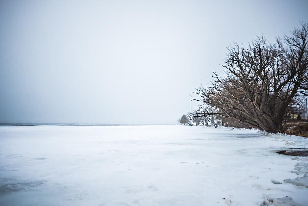 frozen over bear lake adjacent to lake michigan