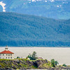 remote lighthouse island standing in the middle of mud bay alaska