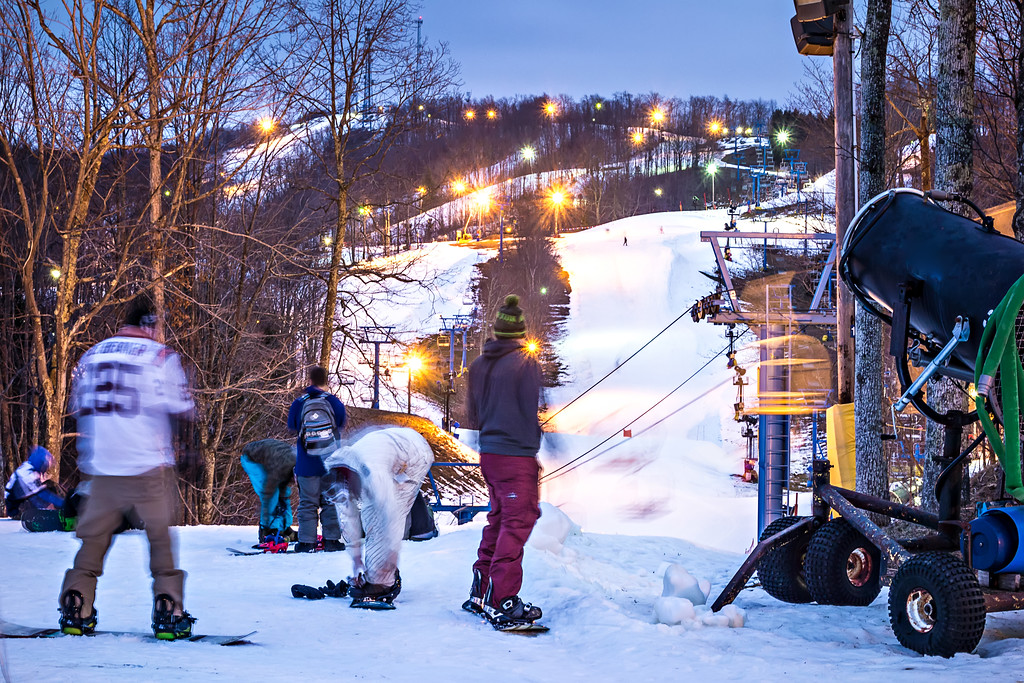 busy ski resort with open evening runs