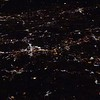 night city views and light while flying over in airplane