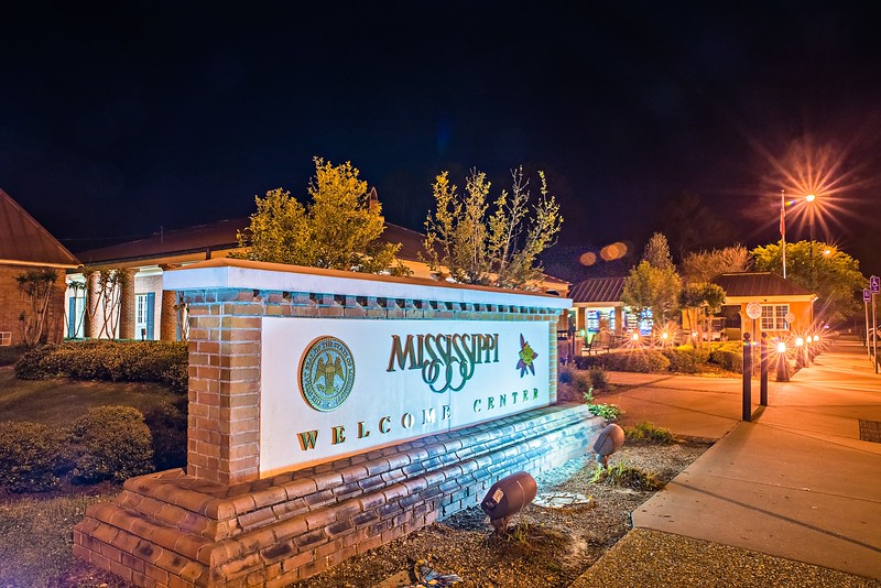 welcome to mississippi visitor center rest area sign at night