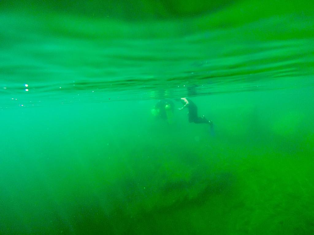 scuba diving underwater in deep quarry