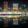 Baltimore  skyline and docks reflecting in the water at night