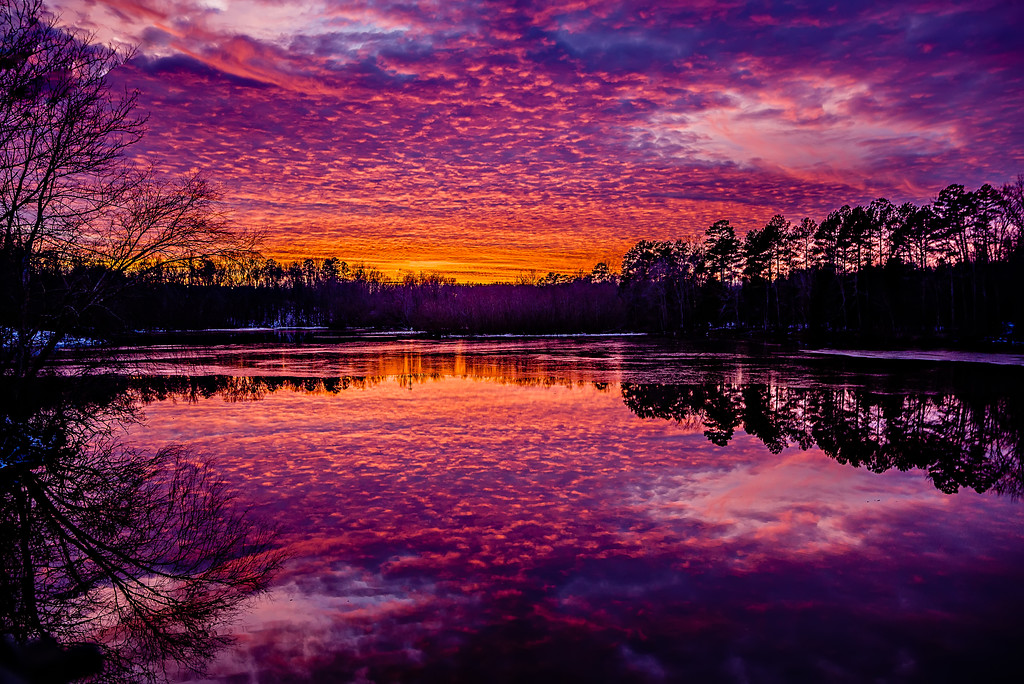 fiery red sunset over a lake