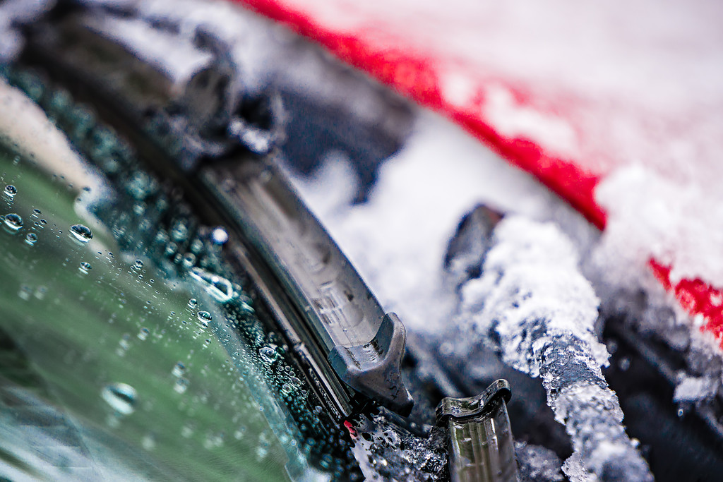 snow and ice covered windshield wipers