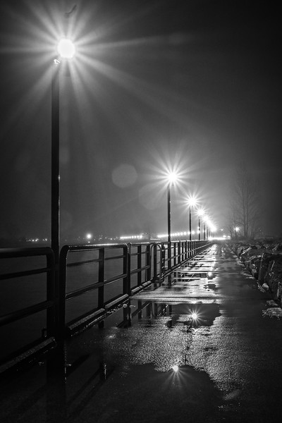 walking along lighthouse pier in grand haven michigan at night